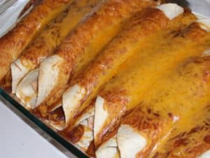 chicken-enchiladas made in a slow cooker - Get the recipe from PassTheSushi.com