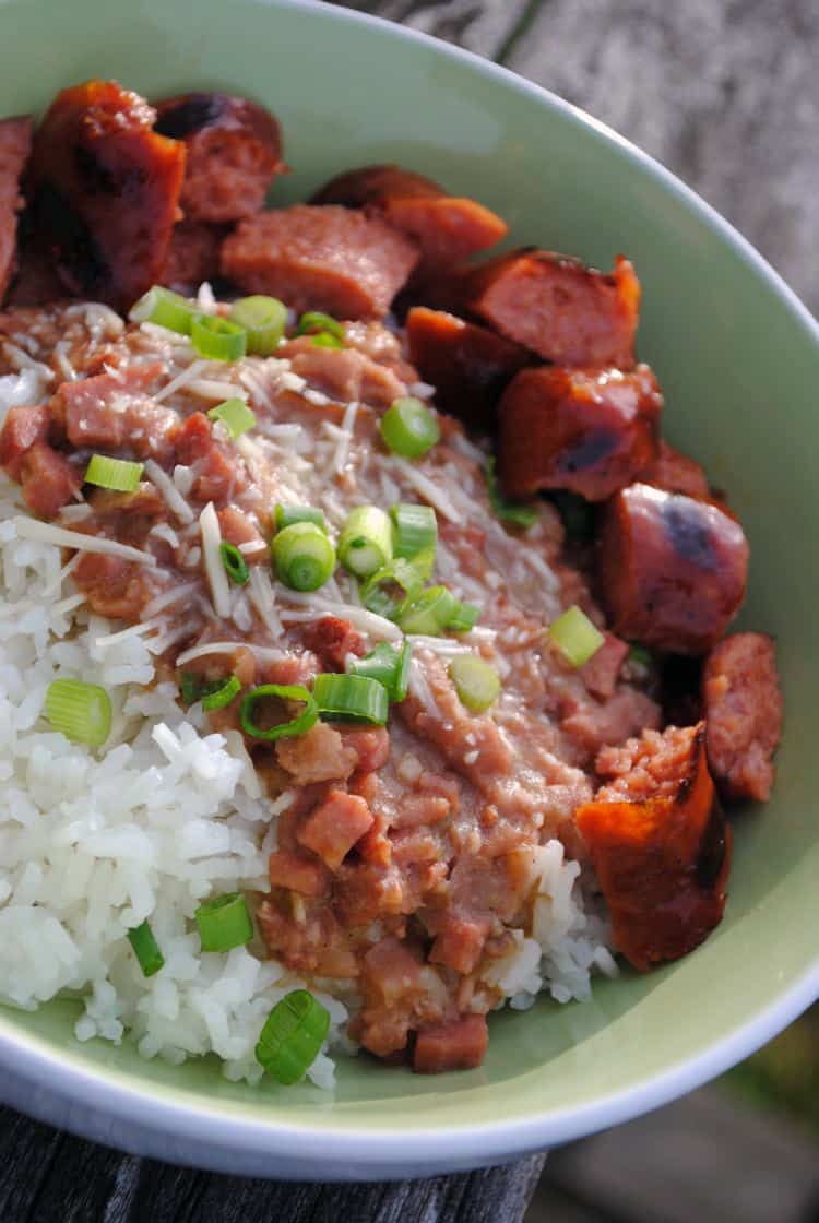 New Orleans style red beans and rice has all of the flavors you expect in Cajun food, plus bacon! Really, you can add just about anything you want with bacon and it will be awesome. | Recipe from passthesushi.com