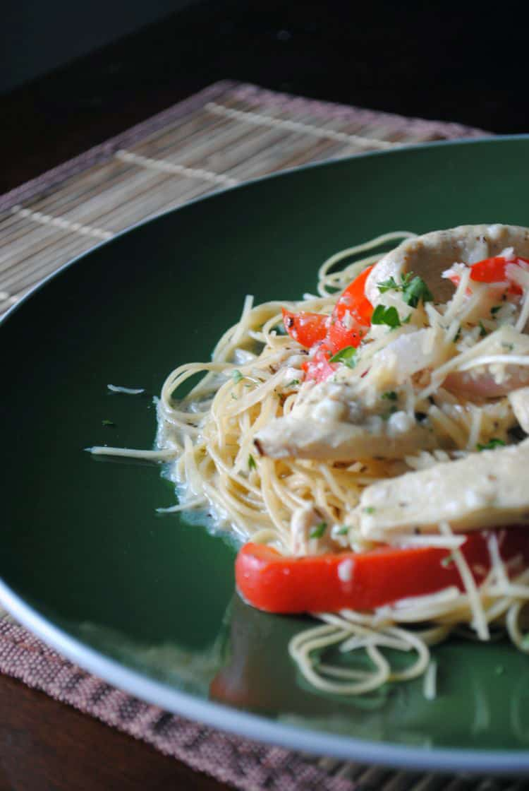 This copycat Olive Garden chicken scampi recipe is perfect for a quick weeknight meal. It tastes great, and it's less expensive to make it at home.