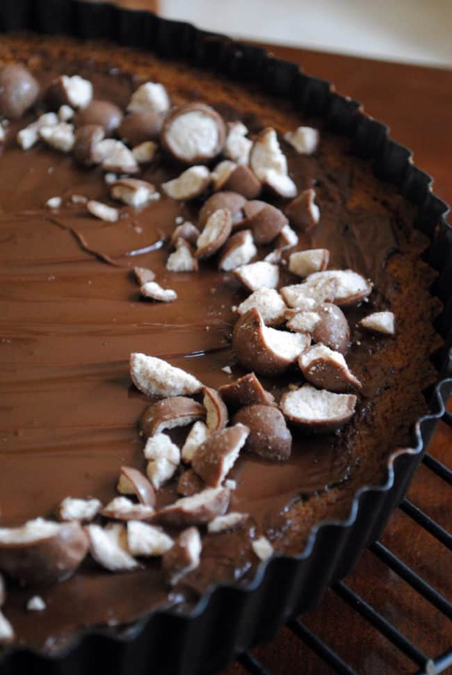 Malted milk cookie tart. A buttery, malted milk cookie crust topped with chocolate and malted milk balls. The dessert of champions! | Get the recipe on PassTheSushi.com