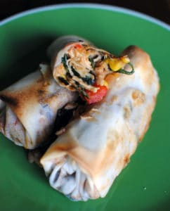 Southwest-style eggrolls are packed with chicken, corn, spinach, and southwest spices. Serve them with a spicy chipotle cream dip for a delicious appetizer or game day snack food. | Get the recipe from PassTheSushi.com