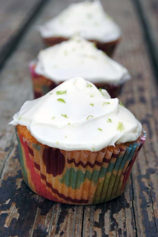 Key Lime Coconut Cupcakes are a taste of summer sunshine. With bright lime and coconut flavors in the moist cupcake and a lime cream cheese frosting on top, you'll want to devour these treats! | Recipe from passthesushi.com
