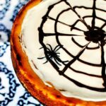 This Halloween pumpkin cheesecake is a rich, creamy pumpkin flavored cheesecake, decorated to look like a spider web. So fun to make! \\ See the recipe on PassTheSushi.com