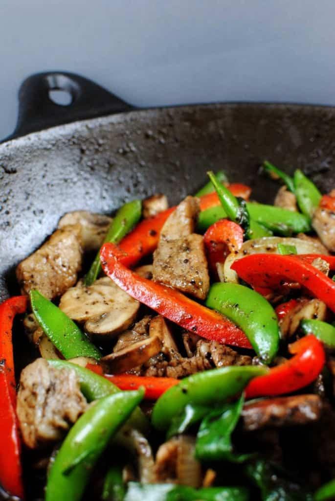 Black Pepper Pork Stir Fry in a wok \\ PassTheSushi.com