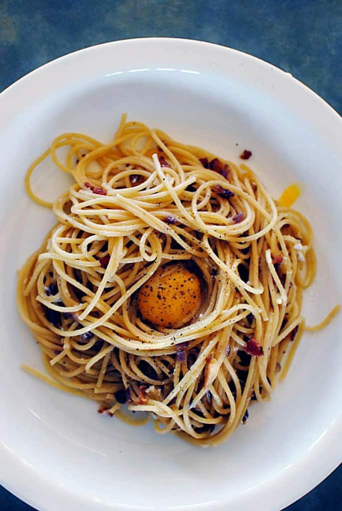 Carbonara is an Italian pasta dish that originated in Rome. It includes eggs, cheese, Italian bacon (guanciale or pancetta), and freshly cracked black pepper. \\ Get the recipe on PassTheSushi.com