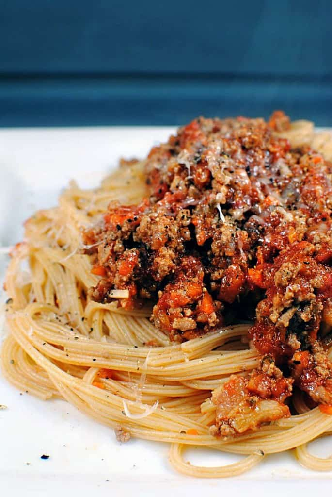 Bolognese Sauce is a hearty Italian meat sauce that's loaded with flavor. Served with your favorite pasta, it's a comfort food dish that you're going to love. \\ Get the recipe on PassTheSushi.com