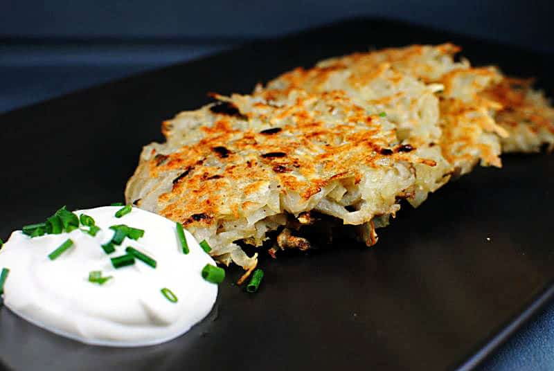 Potato latkes are seasoned, pan fried potato pancakes that are traditionally served for Hanukkah. \\ Recipe on PassTheSushi.com