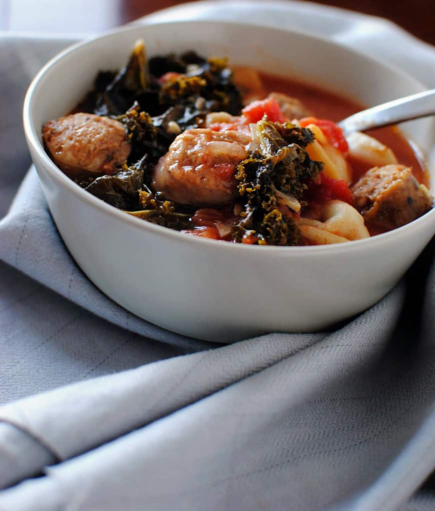 Sausage Soup with Mixed Greens and Cornmeal Dumplings