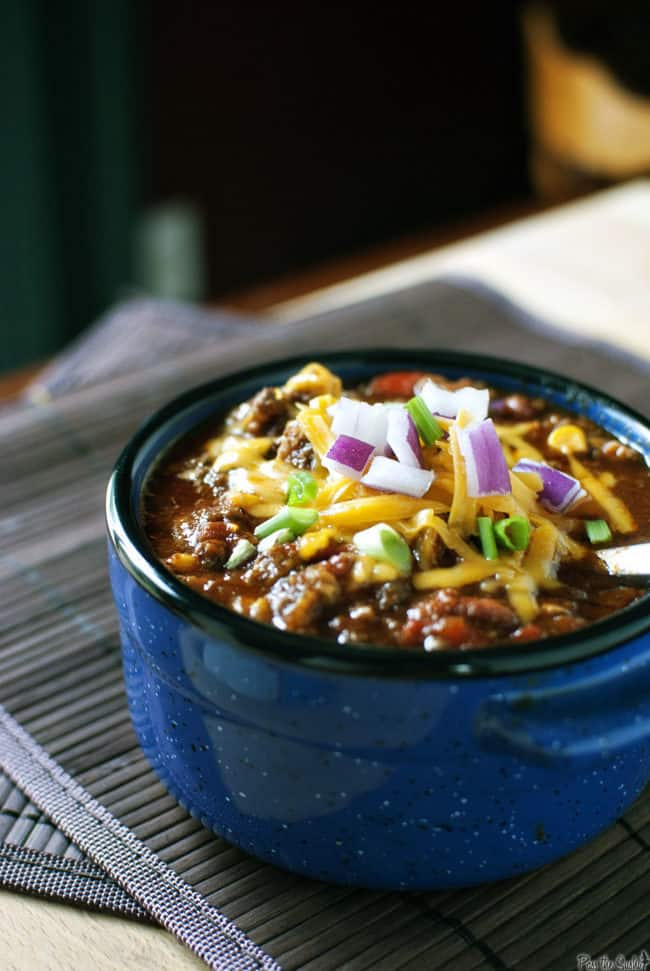 Feed a crowd with this big-batch slow cooker chili. Easy to make, this hearty chili will stick to your ribs and make game day food a heck of a lot better! \\ PassTheSushi.com