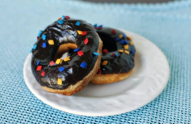Chocolate frosted doughnuts on a plate | passthesushi.com