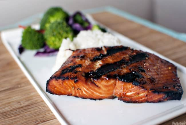 Teriyaki flame grilled salmon is fresh, wild caught salmon, marinated and flame grilled for a healthy, delicious grilled fish dinner. Get the recipe on PassTheSushi.com