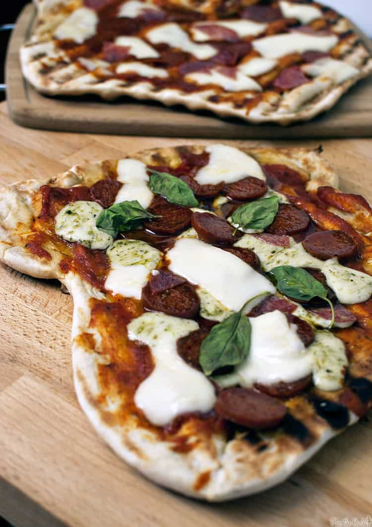 This grilled everything pizza recipe pairs your love for grilling and your love for pizza. Grilled meats, marinara sauce, fresh herbs and hot melted cheese.