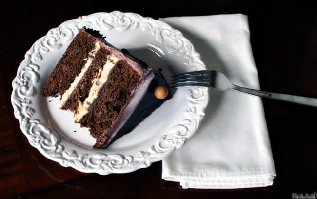 Chocolate peanut butter layer cake. Chocolate cake layered with creamy peanut butter filling and topped with rich chocolate frosting.
