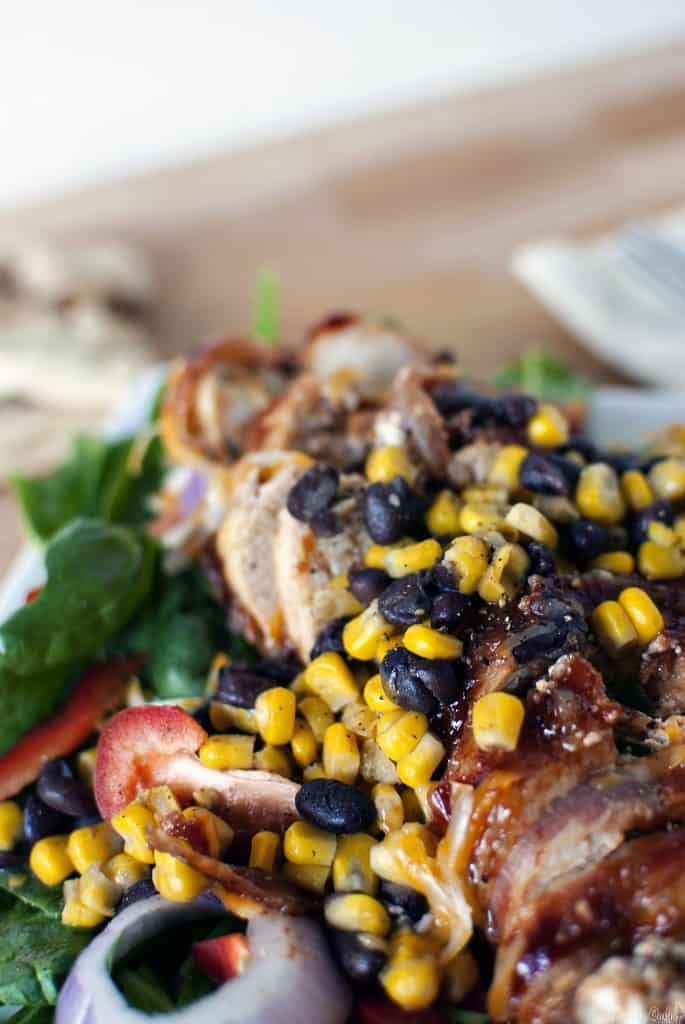 Barbecue stuffed chicken salad takes the best of barbecued chicken and pairs it with a Southwest style salad. Black beans, corn, and jalapenos, along with creamy goat cheese! // PassTheSushi.com