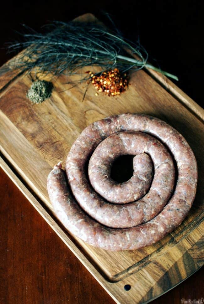 Learn how to make spicy Italian sausage from scratch! From grinding and flavoring the meat to filling and cooking the casings, this post will show you how!