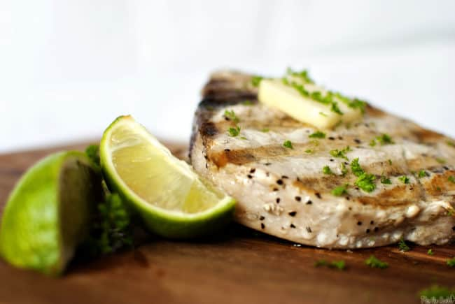Grilled swordfish steaks are easy to make and delicious, too. They look fancy, but they are a no-fuss, flavorful, healthy dinner. // PassTheSushi.com