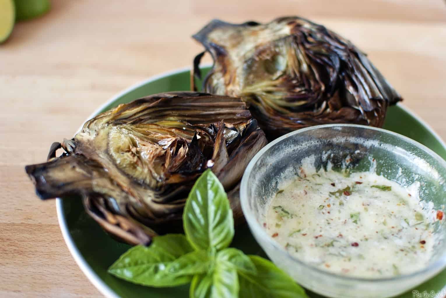 Grilled artichokes have an amazing flavor that you must taste to believe! Grilling artichokes is so easy to do, there's no reason not to try this recipe! \\ passthesushi.com