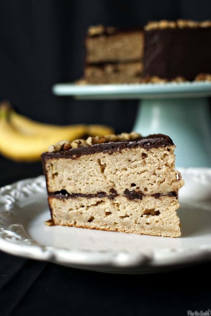 Banana Cake with Chocolate Glaze is a classic banana layer cake accented with cinnamon. The cake is covered in a thick chocolate glaze. \\ PassTheSushi.com