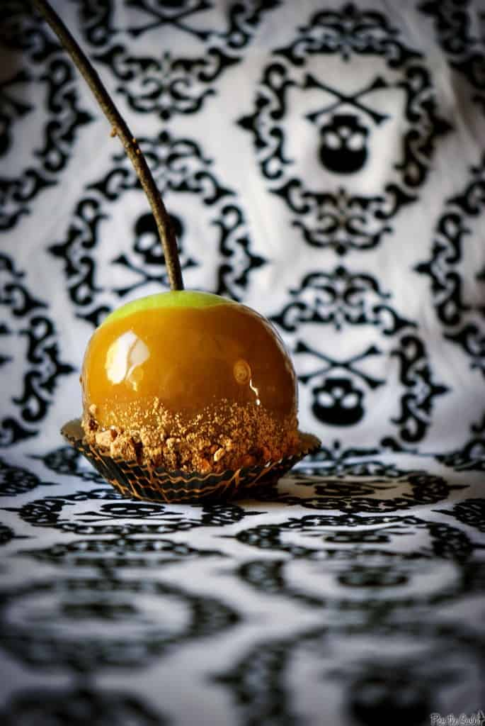 Butterfinger caramel apples will make you the favorite house for Trick or Treat! Tart Granny Smith apples coated with sweet, homemade Butterfinger caramel sauce. \\ PassTheSushi.com
