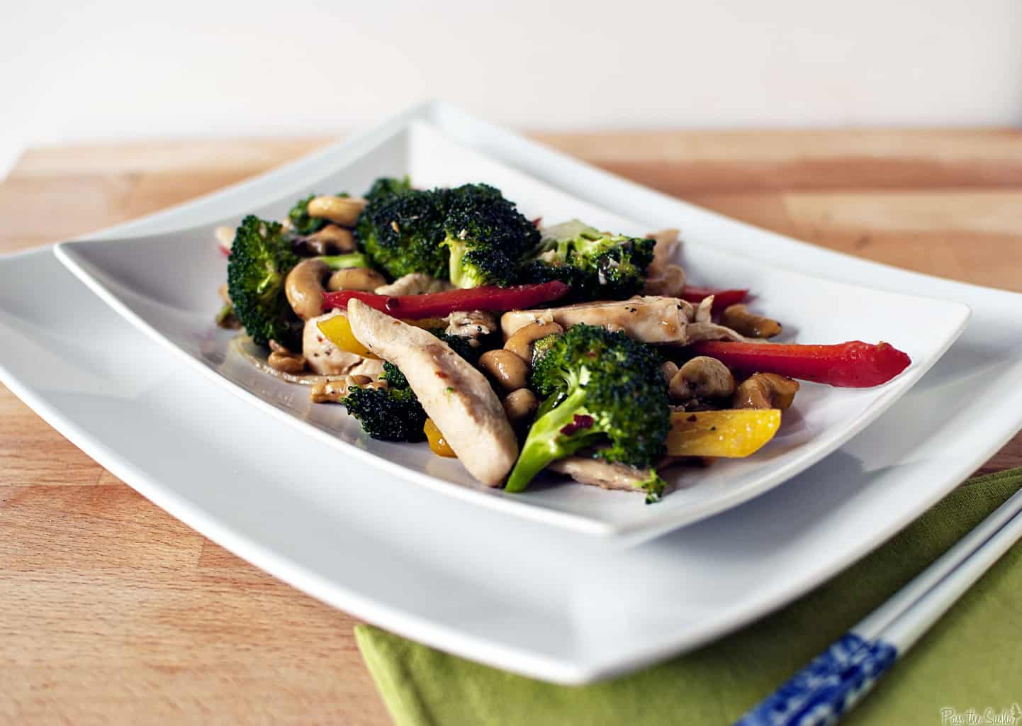 Spicy cashew chicken is a super quick dinner recipe with chicken, broccoli, peppers, cashews, all covered in spicy Asian sauce. \\ PassTheSushi.com