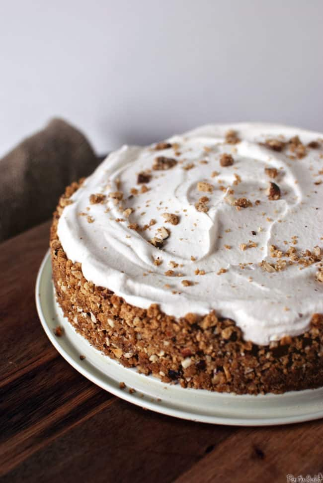 light chai wipped cream over cinnamon pudding pie with crushed hazelnut crust