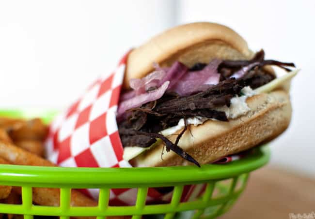 Slow Cooker French Dip Sandwiches are the perfect game day food! \\ PassTheSushi.com
