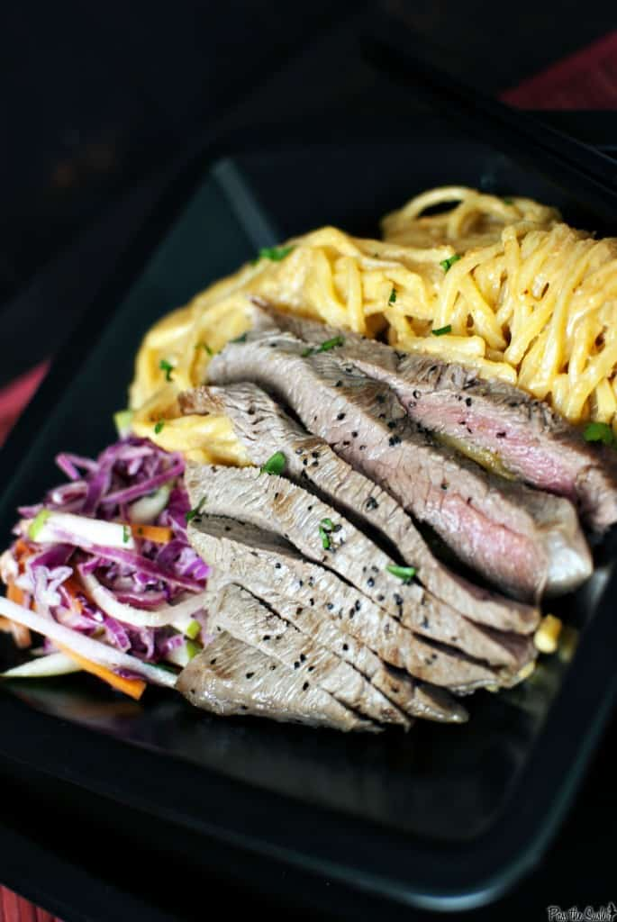 Flank steak, perfectly seasoned and pan seared, sits on a bed of tender egg noodles in a creamy peanut butter sauce. Dinner in 20 minutes! || PassTheSushi.com