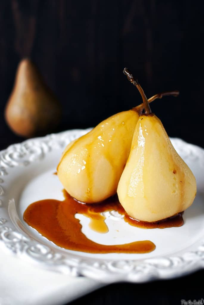 Citrus wine poached pears are a fancy looking dessert that are super easy to make! Bursting with orange flavor and warm fall spices. \\ PassTheSushi.com