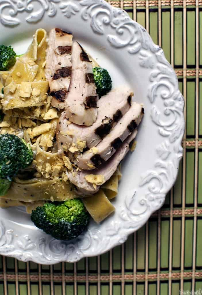 Lemon grilled chicken fettucine Alfredo is a kicked up version of classic fettucine Alfredo. Chicken breast, bursting with lemon flavor, is grilled and served with a creamy Alfredo sauce. PassTheSushi.com
