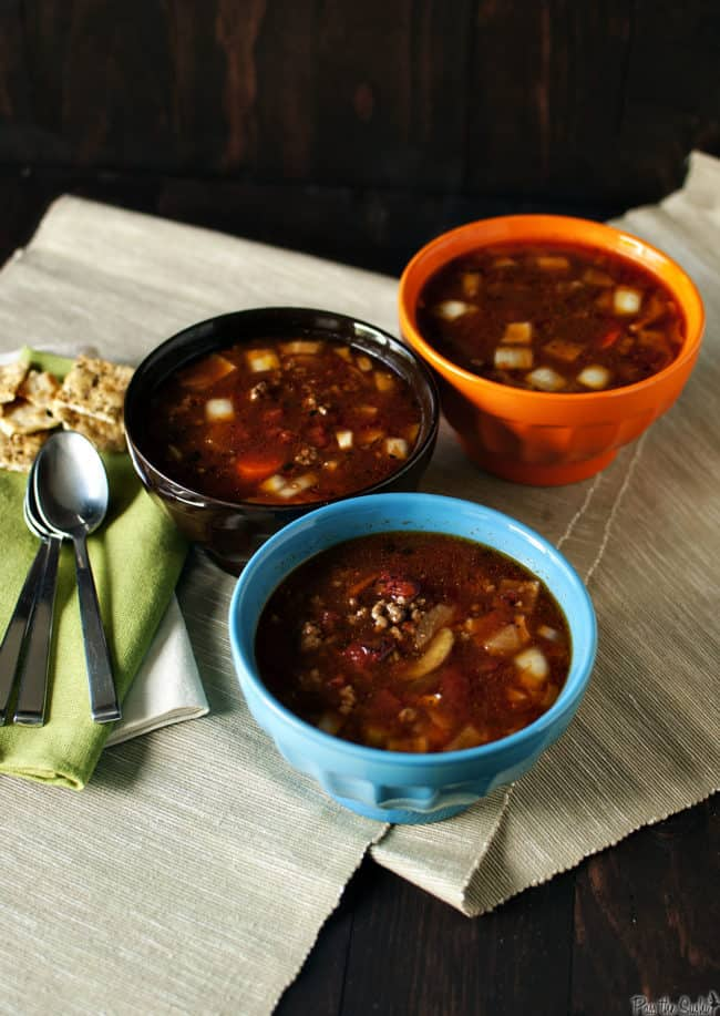 Slow Cooker Hamburger Soup is a hearty, warm, comforting bowl of kid-friendly food. It cooks up quickly, making it a great weeknight meal.  PassTheSushi.com