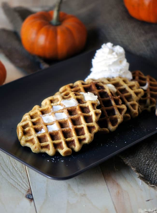 Pumpkin pie waffles are the perfect weekend breakfast. With pumpkin, cinnamon, ginger and clove, these waffles are a taste of fall! \\ PassTheSushi.com