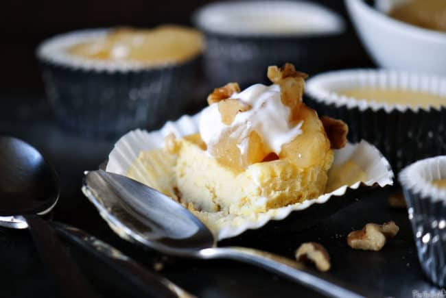 Individual serving cheesecakes topped with fruity sweet apple pie filling. This easy, semi-homemade dessert recipe is sure to make your taste buds happy. \\ PassTheSushi.com