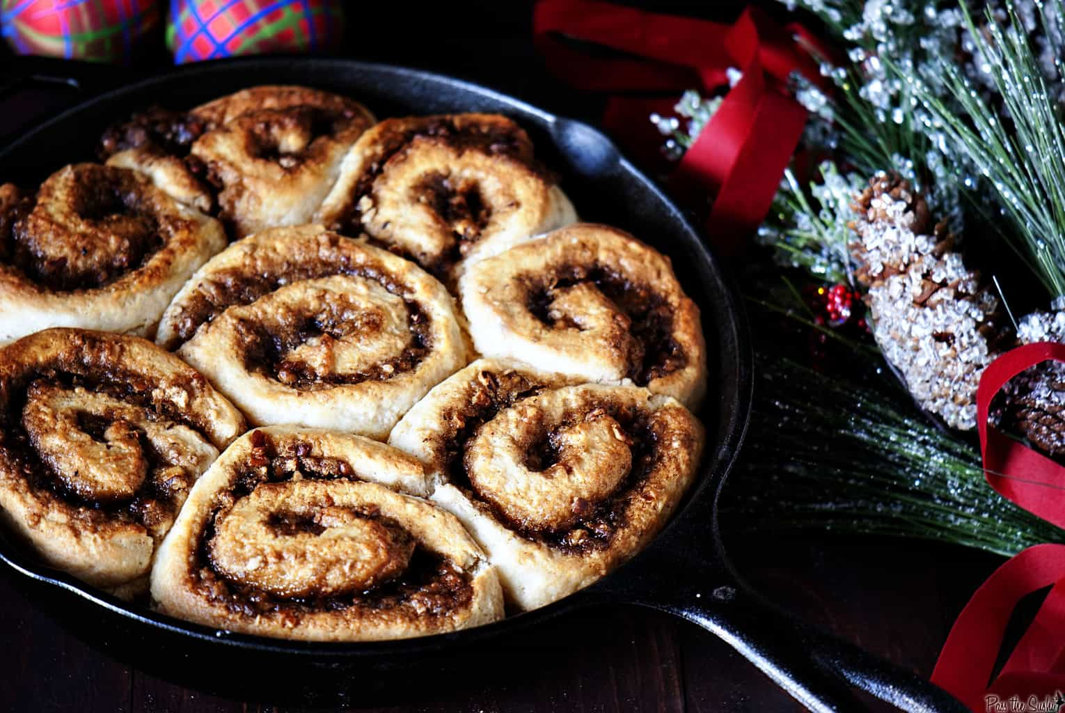 Christmas breakfast becomes more special when you serve a pan of warm maple pecan cinnamon rolls to your family. They're a sweet way to start the day! | PassTheSushi.com