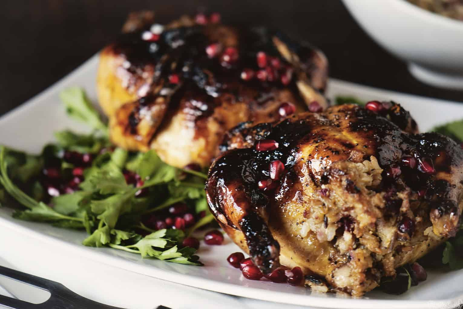 Christmas Dinner at its finest includes making Glazed Cornish Hens with Pomegranate-Rice Stuffing. | PassTheSushi.com