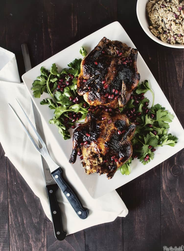 Christmas dinner at its finest includes making Glazed Cornish Hens with Pomegranate-Rice Stuffing. Elegant, but incredibly easy to make, and gorgeous, too. | PassTheSushi.com