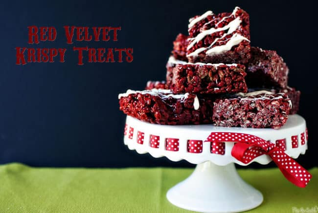 A pile of individual red velvet rice crispies piled up for snacking with a white chocolate drizzle - so good!