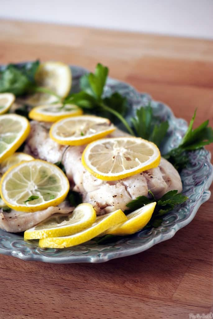 Baked fish is a healthy choice for lunch or dinner. Lemon and fresh parsley give this baked fish dinner a huge burst of flavor. \\ PassTheSushi.com