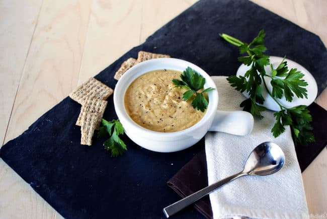 Roasted garlic cauliflower soup is rich, creamy, and despite the lack of meat, it's a hearty, flavorful soup. \\ PassTheSushi.com