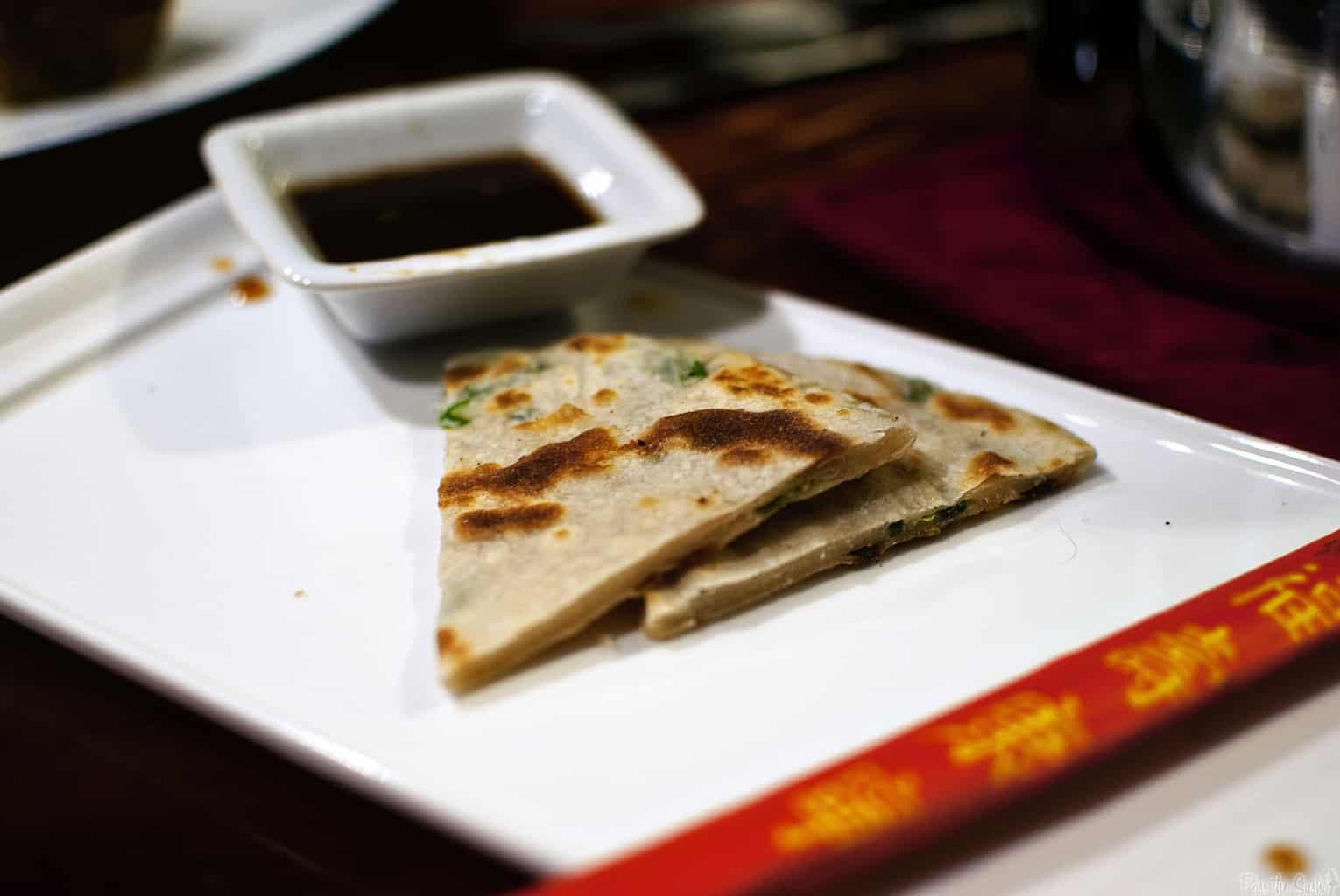 Potstickers and scallion pancakes are two fantastic appetizers to serve as part of a Chinese New Year dinner. Get both of the recipes from PassTheSushi.com