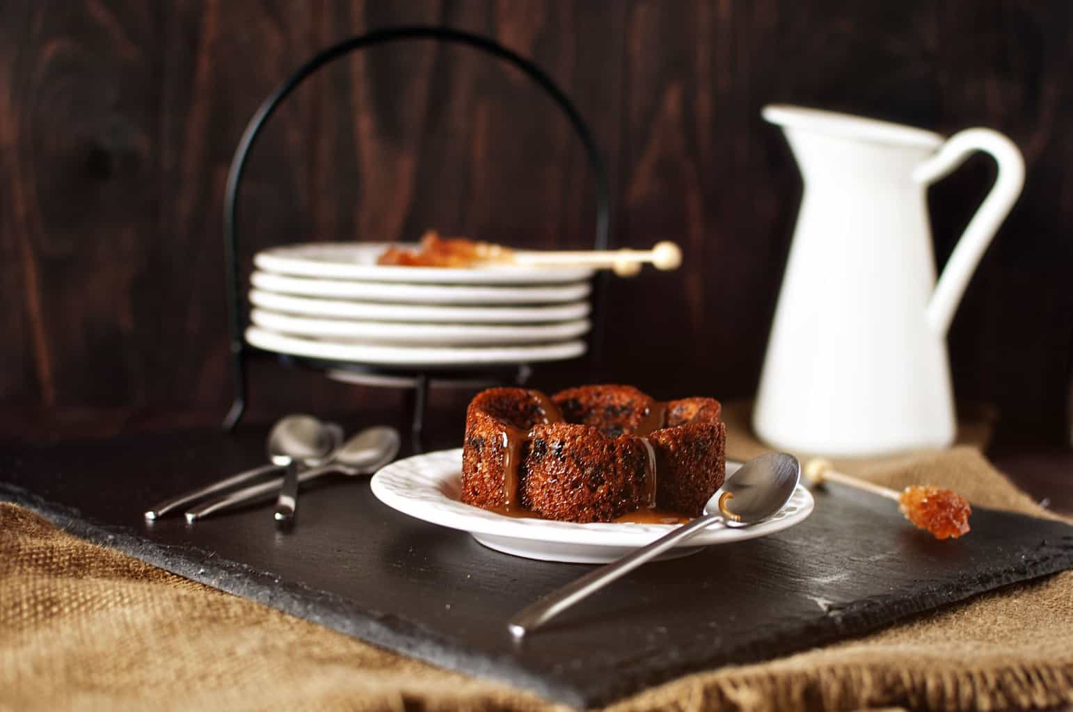 Sticky toffee pudding is a British dessert, made from dates that are baked into a soft sponge cake, then covered in a river of toffee. \\ PassTheSushi.com