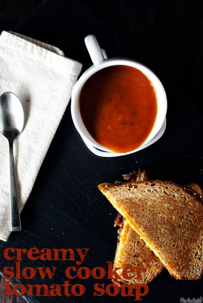 Slow cooker tomato soup is creamy and comforting, and pairs exceptionally well next to a grilled cheese sandwich. This easy slow cooker recipe is a must make! \\ PassTheSushi.com