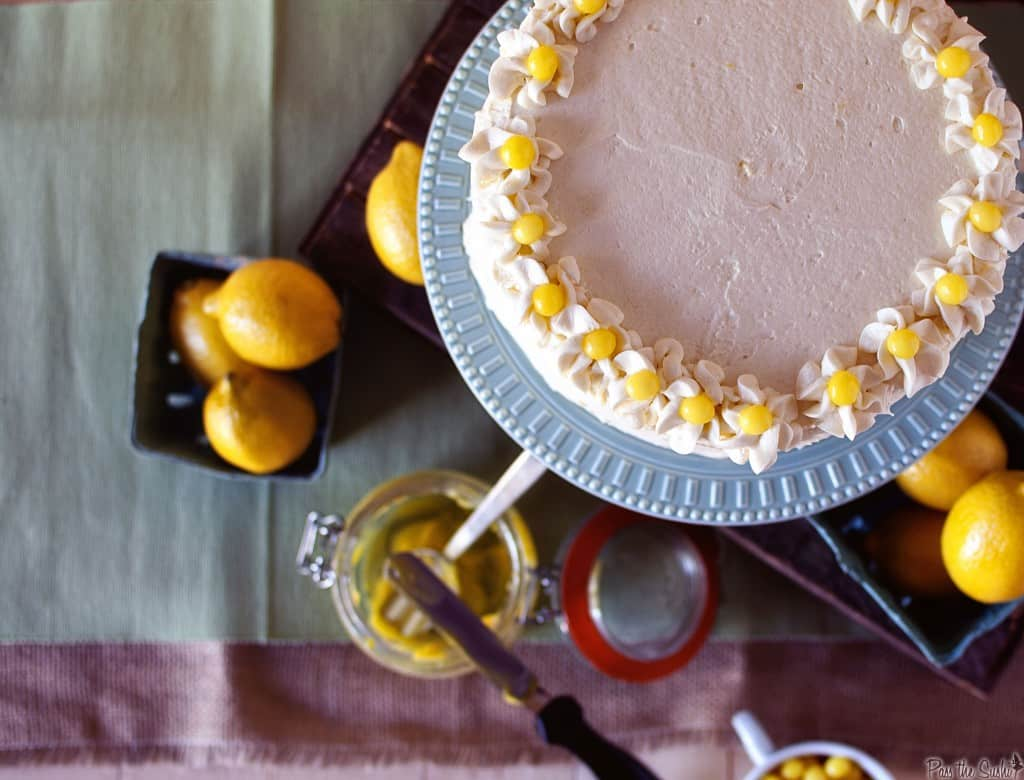 Lemon Drop Cake from above with lemons in a square dish | Kita Roberts PassTheSushi.com
