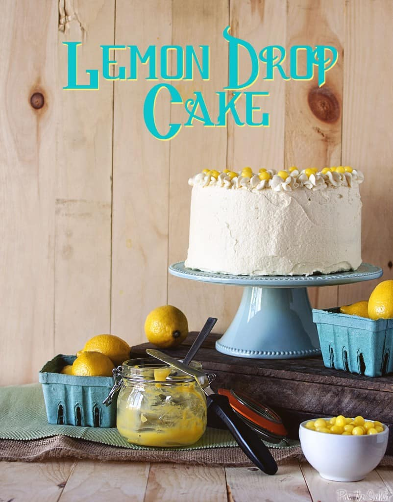Lemon Drop Cake on a stand with jar of lemon curd | PassTheSushi.com