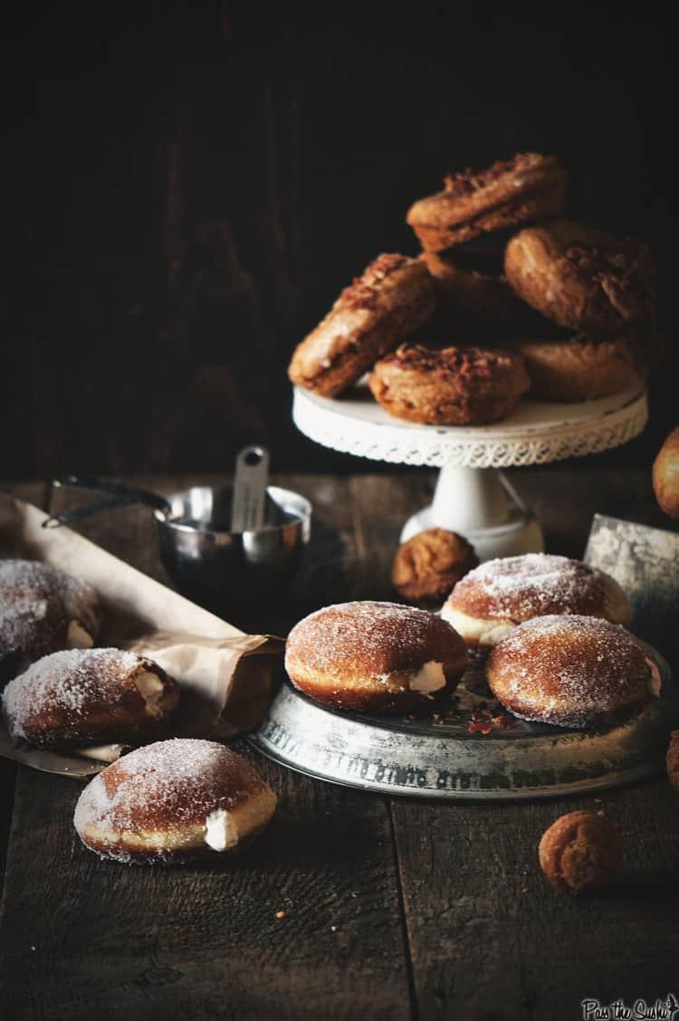 Irish Cream Doughnuts on display with Bourbon Bacon doughnuts in background   Kita Roberts PassTheSushi.com