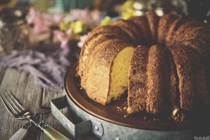 Rum Cake on a wooden platter | Kita Roberts PassTheSushi