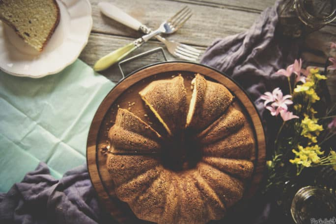 Rum Cake Shown with flowers and napkins | Kita Roberts PassTheSushi