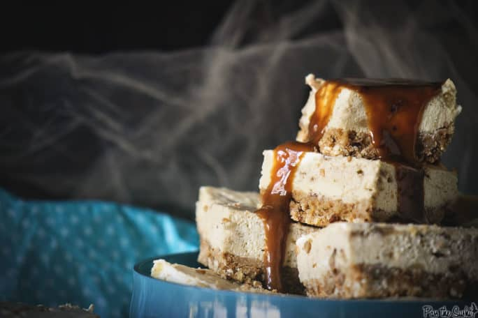 Bananas Foster Cheesecake bars with caramel drizzling over the top