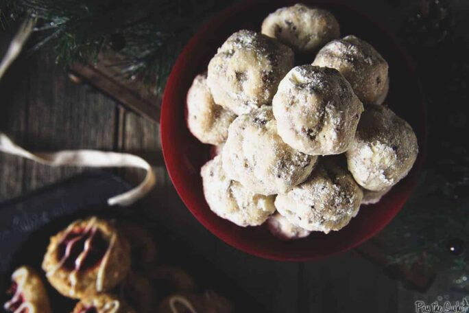 Russian Tea Cake Cookies {Pecan Snowballs} in a red bowl | Kita Roberts PassTheSushi.com