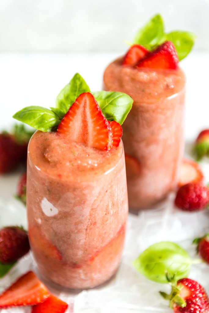 Roasted balsamic strawberries blended for a frozen gin and tonic with basil!