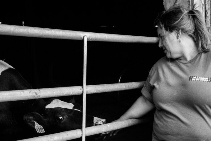 Jenni Tilton-Flood of Flood Brothers farm with cow